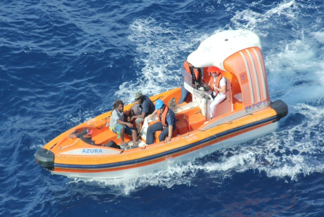 Rescued: The three fishermen are picked up by Azura crew (Picture: P&O Cruises)