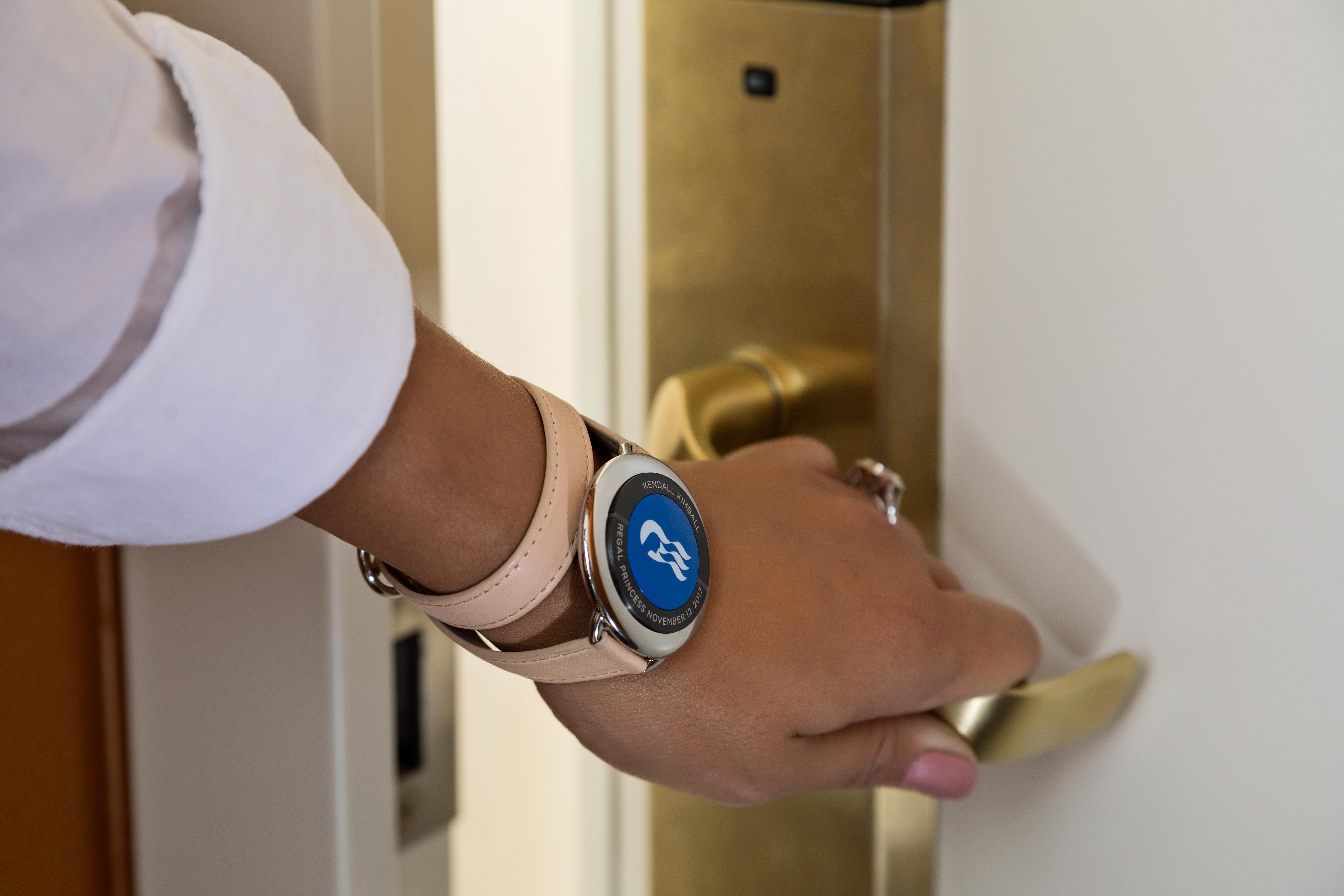 ocean-medallion-close-up-guest-opening-stateroom-door
